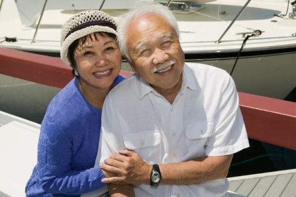 Senior couple embracing in marina
