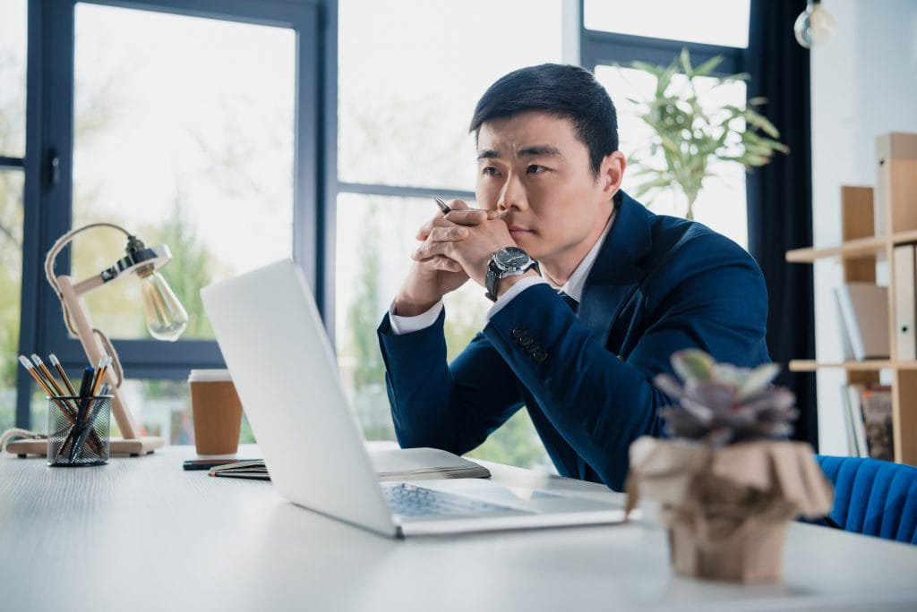 business owner pondering about his retirement plan